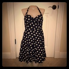 Betsey Johnson 1950's Halter, Swing Style Dress Betsey Johnson 1950's inspired Navy & White Polka-Dot Halter, Swing Style Dress. Size 2. Barely-there, lightly lined chest. Side Zipper. Adjustable Halter Fit (ties around neck). Supportive boning in bodice allows option of wearing as a strapless dress. Hidden pockets. UNBELIEVABLE fit - accentuates EVERYTHING THAT IS GOOD on EVERY BODY TYPE! This dress is feminine, flattering and FABULOUS! Betsey Johnson Dresses Mini