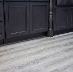 """Are you looking to remodel your house? Are you searching for the best flooring option? We've got you covered! We understand that it can be confusing seeing various acronyms for floors that don't make much sense to the average consumer.  If you've recently come across """"SPC Flooring"""" labels, it means Stone Plastic Composite Flooring. Visit our blog to learn more! #SPC #SPCflooring #kitchenflooring #kitchenfloor #bathroomflooring #bathroomfloor #spcvinylflooring #spcflooringlivingroom Best Flooring, Flooring Options, Vinyl Flooring, Flooring Ideas, Living Room Flooring, Bedroom Flooring, Kitchen Flooring, Lily Ann Cabinets, Composite Flooring"""