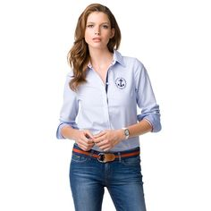 This Oxford-inspired shirt is designed to turn heads: striped accent lining inside and underneath collar, along the placket and inside the cuffs. Insets at the hem. Accent metal buttons at the cuffs. Tommy Hilfiger logo on chest and sleeve. Accent stitching along elbow patches. Shirt tail hem. Our model is 1.76m and is wearing a size S Tommy Hilfiger blouse.