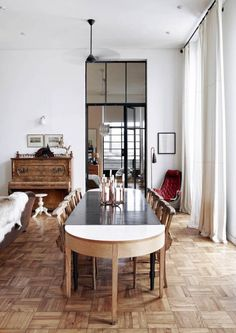 This eight-floor apartment in Cape Town is housed in an Art Deco building dating back to 1939. The enormous black steel-framed windows, high ceilings and parquet flooring are a great back drop to this