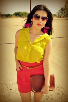 70's inspired look...neon yellow blouse + high waisted coral shorts + feather earrings + leopard platforms