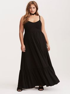 """The black jersey knit on this maxi dress is so soft and stretchy you'll never want to take it off. The maxi skirt is totally boho with a tiered construction. The adjustable spaghetti straps are a flirty contrast to the very sexy paneled bodice.<div><br></div><div><b>Model is 5'8.5"""", size 1<br></b><div><ul><li style=""""list-style-position: inside !important; list-style-type: disc !impo..."""