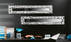 The Mito metal frame mirror features a crushed aluminum frame.