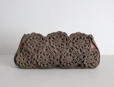 vintage 1940s extra large brown cordé clutch. ornate doily weave with scalloped top edge. lined in a thick faille-silk, with two compartments. metal
