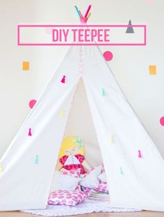 This teepee would be such a fun project for the kids. Love the modern design and bright pops of color!