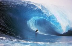 Bodyboarding big wave barrel.