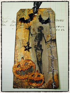 From Tim Holtz Blog   http://timholtz.com/tricks-treats/#Halloween1