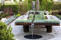 Planted table with water runnel designed by  Suzanne Biaggi & Patrick Picard
