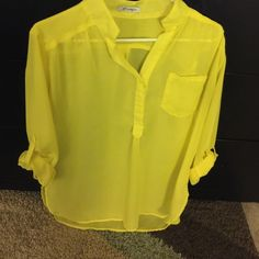 🌼Yellow sheer shirt Yellow hi-low shirt (hi- low isn't dramatic but it has a couple inches on the back part and front isn't a belly shirt it's normal length) perfect to wear with leggings and a tank top under it Xtaren Skirts High Low