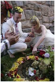 Placing our offering into the ground...one of my favourite pictures!