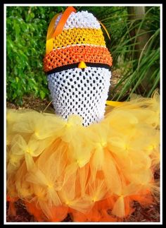 Hey, I found this really awesome Etsy listing at http://www.etsy.com/listing/56184381/candy-corn-sweetie-crocheted-tutu-dress