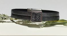 Doubled 5mm metallic silver flat leather and a stunning swarovski crystal and crushed silver beaded square focal slider comes to a close with a smooth zamak greek cast magnetic clasp to a finished length of 7 inches.  Slider - swarovski crystal/crushed bead focal - 1/2 inch square - beautiful Leather - doubled 5mm flat leather - metallic silver Length measures 7 inches. I will send this to you in a box wrapped with a pretty ribbon ready for gift giving.  This adornment for your wrist…