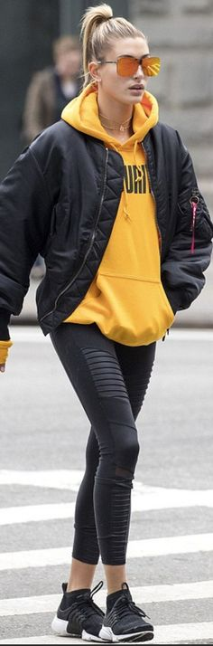 Who made Hailey Baldwin's black bomber jacket, leggings, and sneakers?
