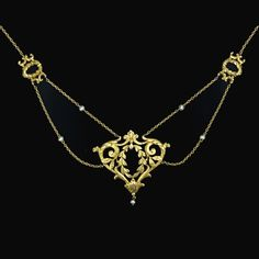 Beautiful 18kt gold Art Nouveau necklace with seed pearls found on gemgossip.com who found it listed at langantiques.com.