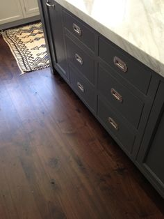 Navy/gray cabinets, campaign hardware, marble via: Tracery Interiors.