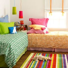 Decorate A Shared Bedroom - Kids begin to develop their own taste earlier than you may think. Play with color and pattern in a shared bedroom to help delineate space. Discover more kids room decorating and organizing tips and ideas @ http://kidsroomdecorating.net
