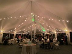 Tent Top Lighting in Pole Tent; Ebb Tide Tent and Party Rentals & Pink and Amber lighting under a Rope and Pole tent in a park ...