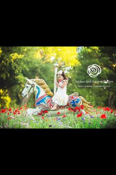 From Birdie Baby Boutique. I need to do this with Bailey! Where can I find a carousel horse?? :)
