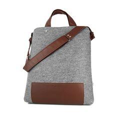 MAXI felt bag - Purol Design  MAXI is a bag made of felt and leather, fastend with a zip. Convenient to carry in hand or on arm, also as a postman bag.