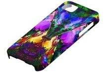 Valxart.com has lots of colorful iphone cases for iphone cases. See http://www.pinterest.com/valxart/apple-iphone-5-covers-cases-by-valxart/