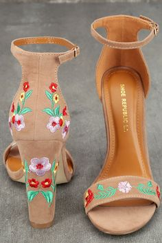 Be unstoppable in the Suri Taupe Embroidered Ankle Strap Heels! These stunning heels have a vegan suede peep-toe upper, and matching heel cup with adjustable ankle strap (and gold buckle). Red, green, pink, and yellow floral embroidery completes this bold look!