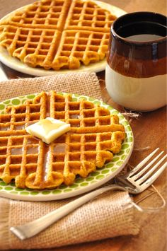 A sweet and crisp cornbread waffle infused with pumpkin flavor and topped with lots of vegan butter and maple syrup!
