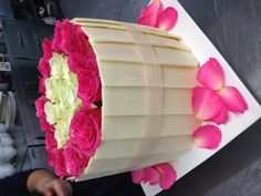 Vanilla cake with strawberry frosting and white chocolate collar