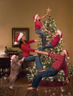 fabulous christmas card of a family helping each other get a star on the tree