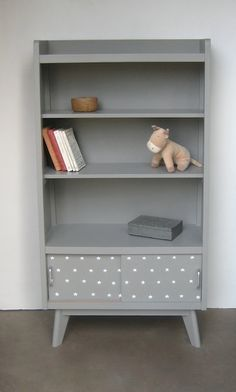 Adorable star print on the bottom of this bookshelf.