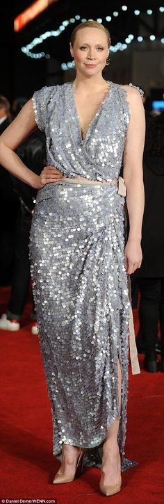 Sequinned: Gwendoline Christie excitedly walked the red carpet in a glittering dress cover...