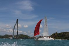 Adrenalin and Hurricane battling it out at the finish of the last race (from Koh Phi Phi Don to Phuket) of The Bay Regatta March 4 - 8. Adrenalin took line honours.