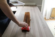 GREAT instructions for finishing butcher block countertops! Chris Loves Julia: Our Walnut Countertops--Sanded, Sealed and Finished!
