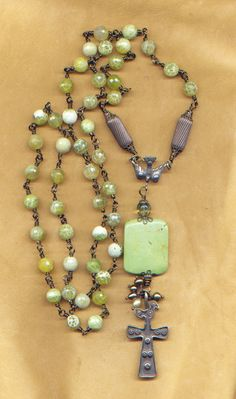 Rosary-style necklace of lime crackle agate and brass; hand-crafted wirework