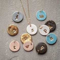Beautiful new arrivals at Bella Vita. Clay initial charms by Susan Gordon. Great Christmas gift ideas!
