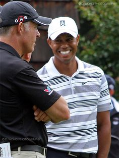 Tiger Woods smiling while talking with old caddie Stevie Williams.