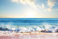 Ocean waves lap the sand on the beach.