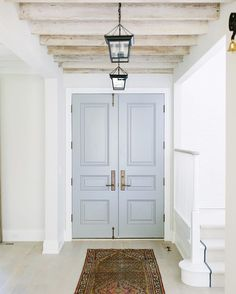 In the middle of the week, foyer beams and a double front door just work! #katemarkerinteriors #newbuild