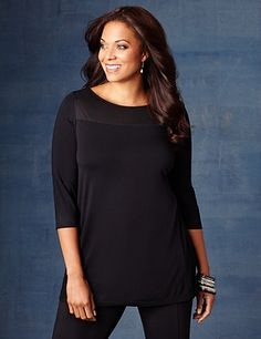Discover perfectly versatile pieces from our AnyWear Collection that mix, match and pack beautifully, wherever life takes you. Our unique tunic comes in allover soft knit with a silky mesh patch at the scoop neckline for a touch of texture. Three-quarter sleeves. Catherines tops are designed for the plus size woman to guarantee a flattering fit. catherines.com