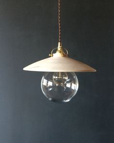 The Edmund Light has a wood shade and a clear glass globe . Clean and Simple