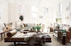 i love all these neutrals and lots of places to sit...would probably make it slightly less modern