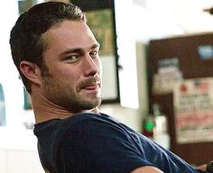 Pin for Later: 23 Times Taylor Kinney Was the Sexy Firefighter of Your Dreams When He Bit His Lip