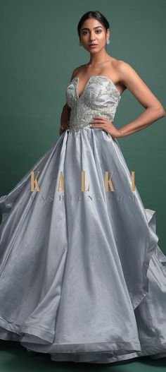 Buy Online from the link below. We ship worldwide (Free Shipping over US$100)  Click Anywhere to Tag Powder Blue Strapless Ball Gown In Shimmer With Plunging Neckline And Floral Embroidery Online - Kalki Fashion Powder blue strapless ball gown in shimmer.Adorned with sequins and zardozi embroidered floral pattern on the bodice.Crafted with tube neckline with plunging neckline and high low cut layers.