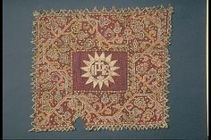 Fillet embroidery. Nets of red silk with embroidered border with creeper plant in gold, silver, blue, light green and bright red silk. The center applied strålsol with the IHS monogram, in guldläggsöm on a sheet. Bobbin lace fringed with gold and silver lace C. 1600