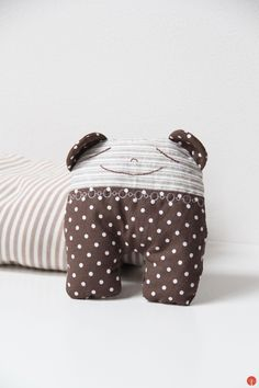 Hand made sewed kids fabric toy in bed