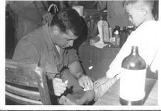 My Story.  Yelling Through The Rage  -  Forty-six years of living with combat-related PTSD.  Photo: My husband holding clinic in Vietnam.