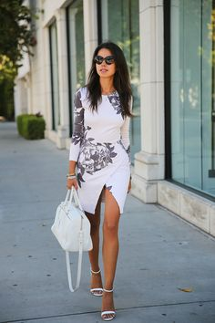 VIVALUXURY - FASHION BLOG BY ANNABELLE FLEUR: FITTED FLORAL Maurie & Ever Madison Floral dress via NastyGal { also love this color } | Saint Laurent classic duffle bag via Ssense { in white here, also love this red version } | Zara heels | BanLook Rococo Licorice sunglasses | Vita Fede jewelry: mini titan crystal bracelet, original titan bracelet, ultra eclipse crystal midi ring, ultra mini titan crystal ring & Capri 5 wrap bracelet  August 21, 2013