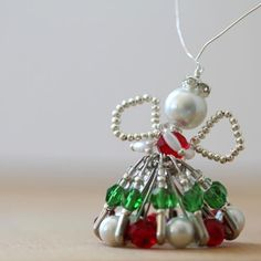 Silver and Pearl Safety Pin Angel Ornament | Use household items and beads to create this lovely angel ornament.