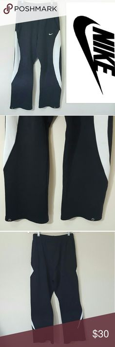 Nike | men's sport pants | medium In excellent condition!  Men's Nike sport pants Size medium.  Snaps around the ankle. Loose fit.  Used item, some signs of wear shown by pictures  Offers welcome! Nike Pants Sweatpants & Joggers