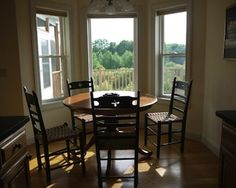 A sunny breakfast nook brightens the kitchen in this contemporary property in Dalton located within the Silver Maple community. Privately sited at the end of a quiet cul-de-sac, the property has one-of-a-kind views of October Mountain. The home, built in 2004, has been maintained with such love and care it looks brand new, with high-quality touches throughout.