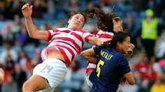 Abby Wambach of USA battles with Nataly Arias of Columbia